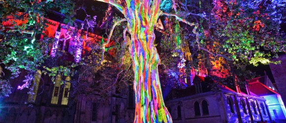Multi-coloured light show on Bayeux Cathedral at night