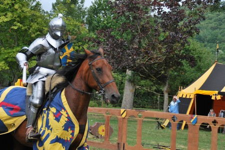 Jousting knight on horse at Crevecoueu medieval festival in Normandy