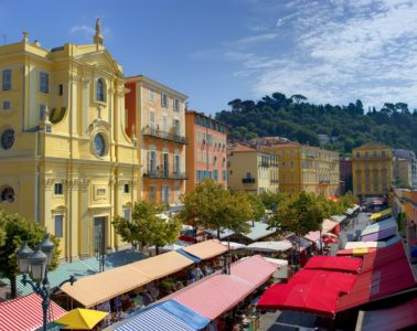 View from above of the Cours Saleya market in Nice with covered stalls and old buildings