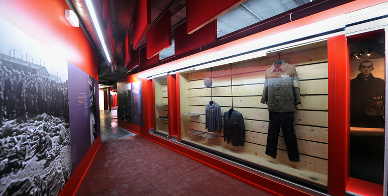 Clothing and displays in the concentration camp display at La Coupole