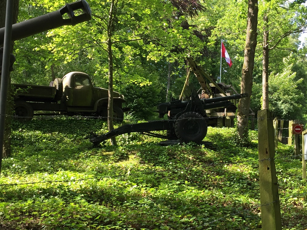 Forest path at Eperlecques with old guns, vehicles and weapons from WWII