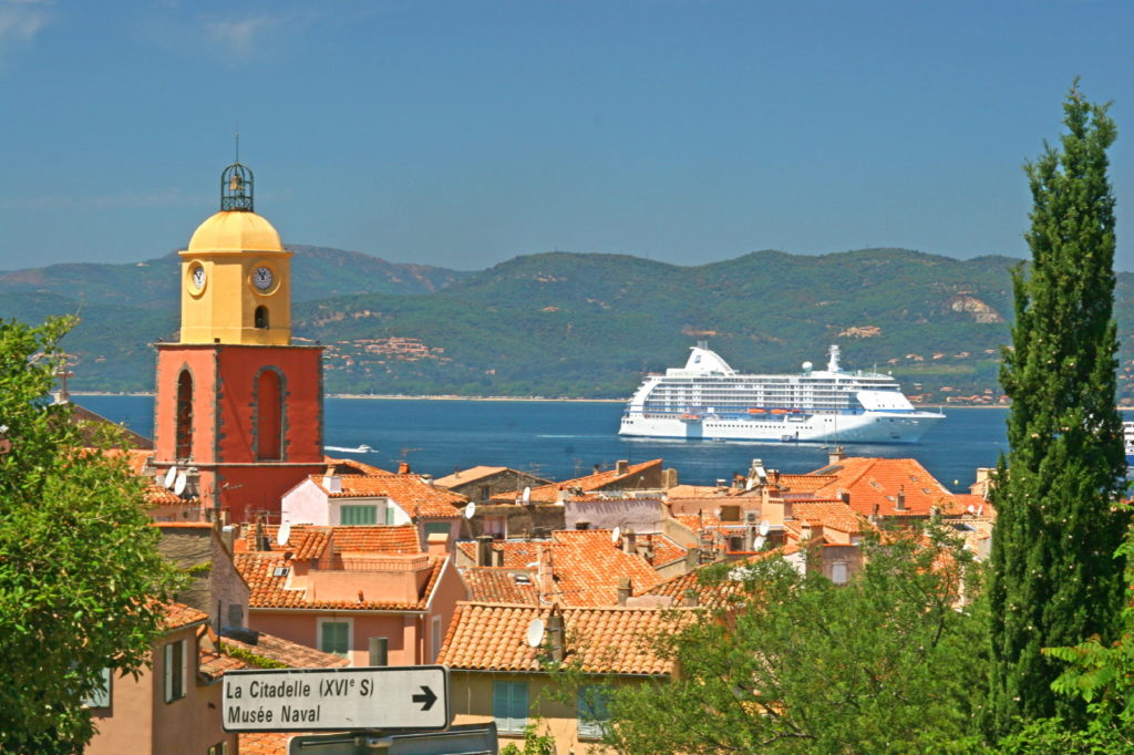 View over St Tropez with church in foreground, red rooves and sea