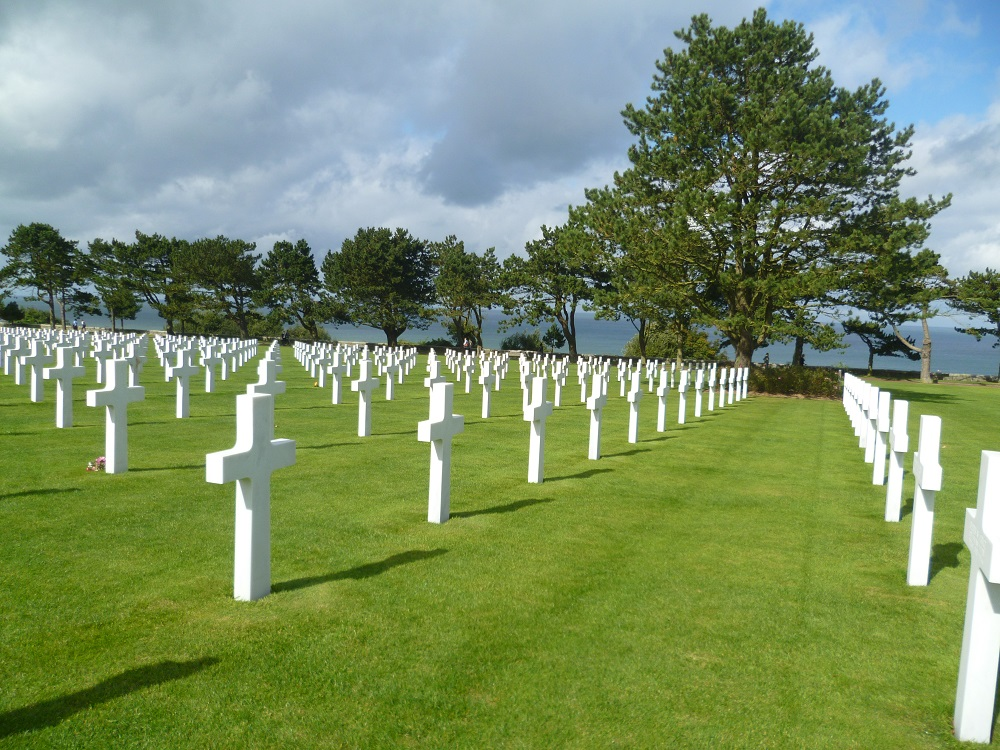 White gravestones above blue sea at Normandy American Cemetery, Colville-sur-Mer