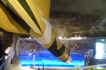 V2 rocket hanging over displays at La Coupole