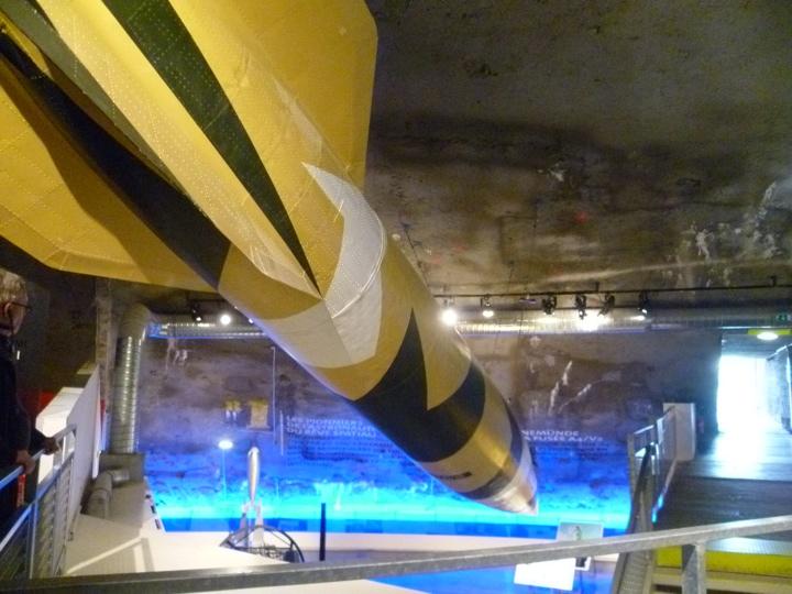 V2 rocket hanging over displays at La Coupole