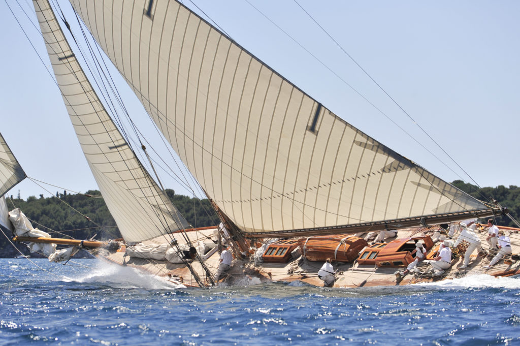 Racing yacht off Antibes half way over at full tilt