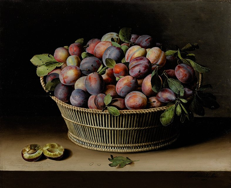 Still life of bowl of plums