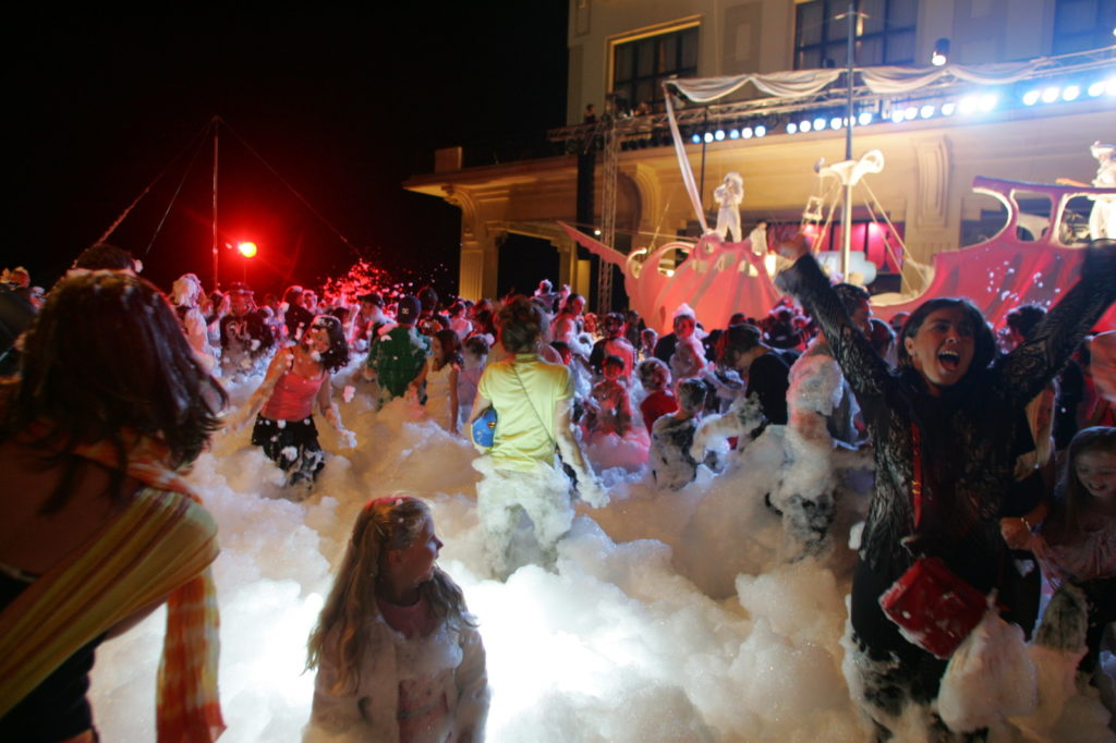 Street party at night at Biarritz with smoke and foam
