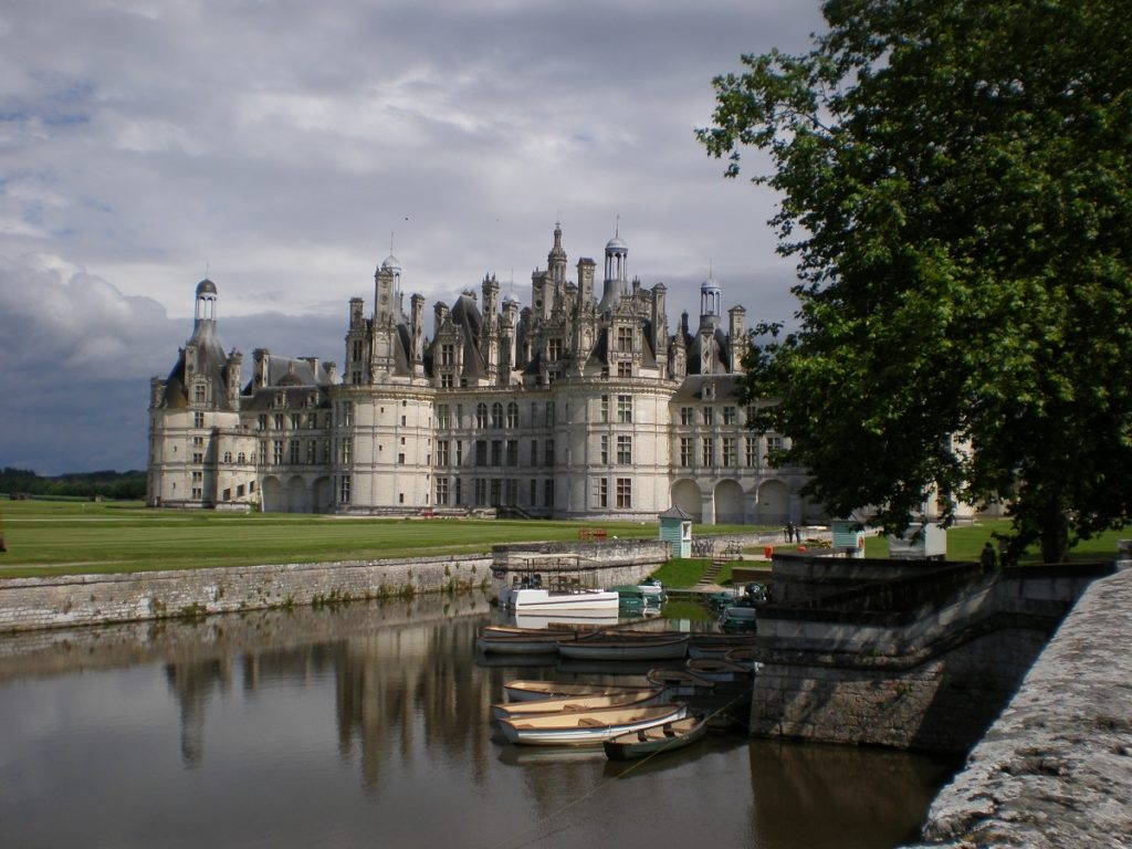 Huge white chateau of Chambord in front of the river