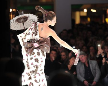 Model on catwalk in white and dark chocolate dress at Paris Chocolate Show