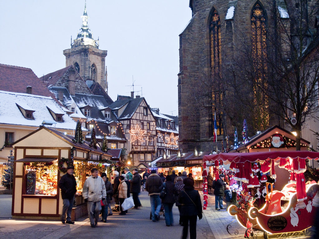Colmar christmas Market with lit stalls and snowy rooves
