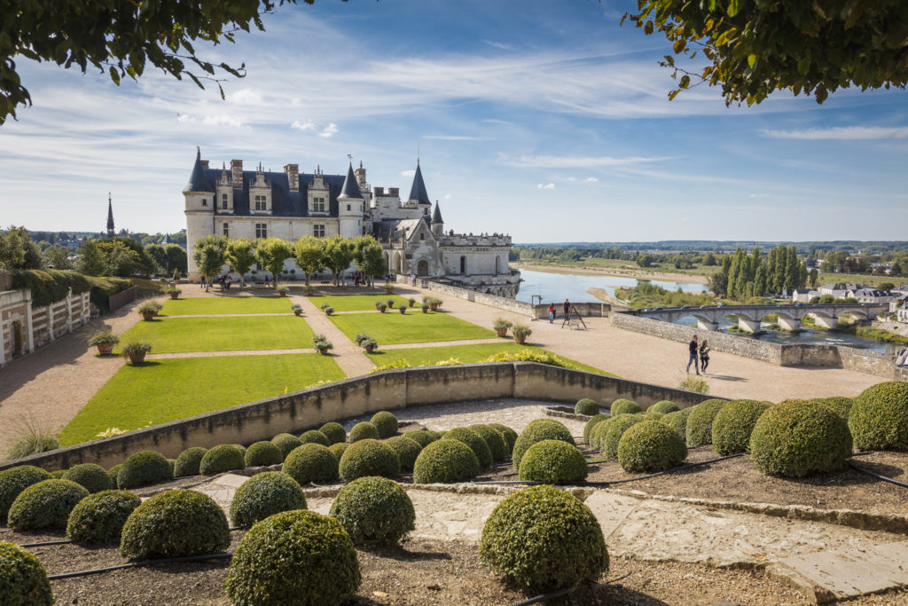 Royal Amboise Chateau in background overlooking Loire with formal gardens in front