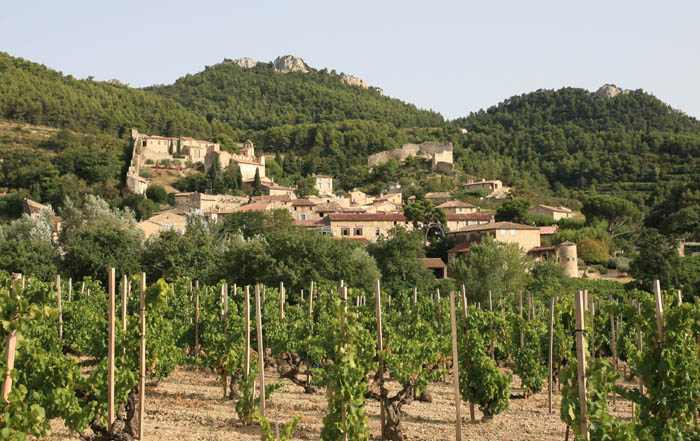 village of Gigondas of stone houses perched on a hill from afar
