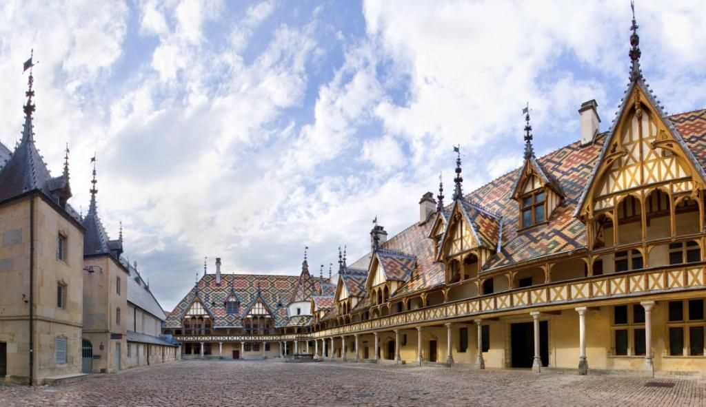 hospice de beaune old buildings with coloured tiles
