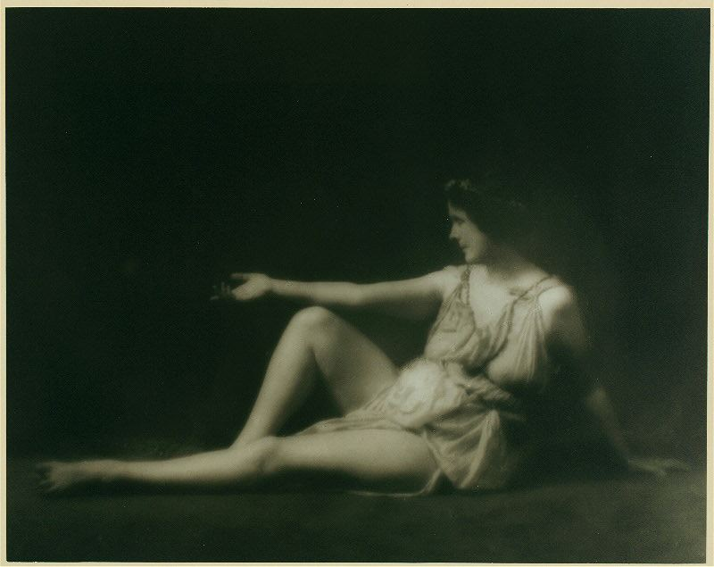 B/w photo of Isadora Duncan sitting on floor scantily clad!