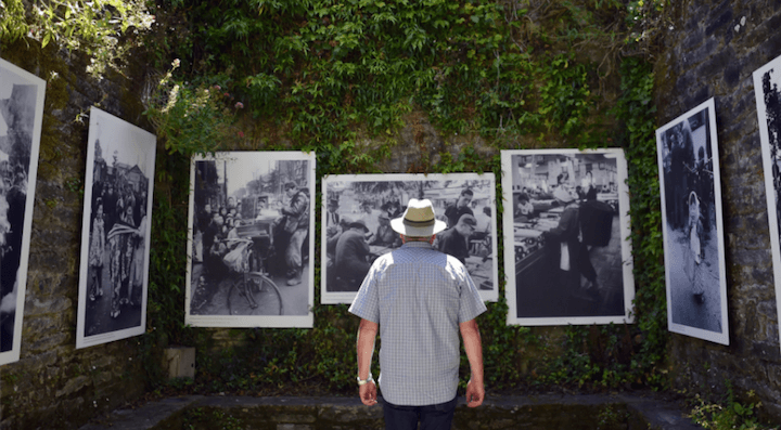 La Gacilly photo festival. Man in front of photos outdoors