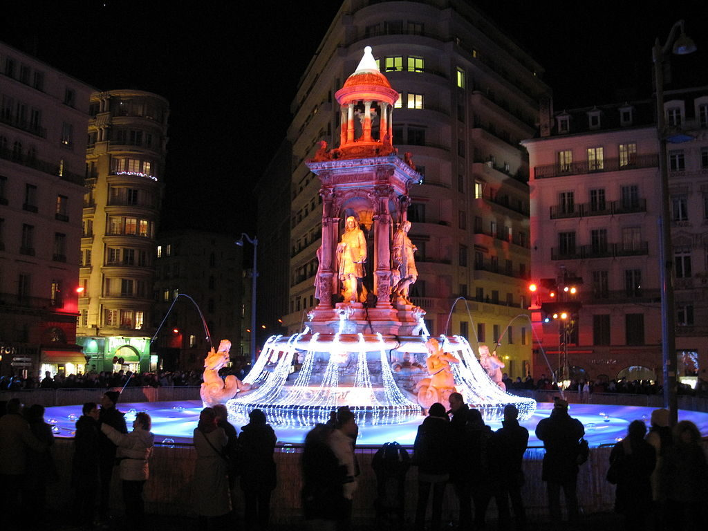Fete des lumieres in lyon with fountain brilliantly lit up