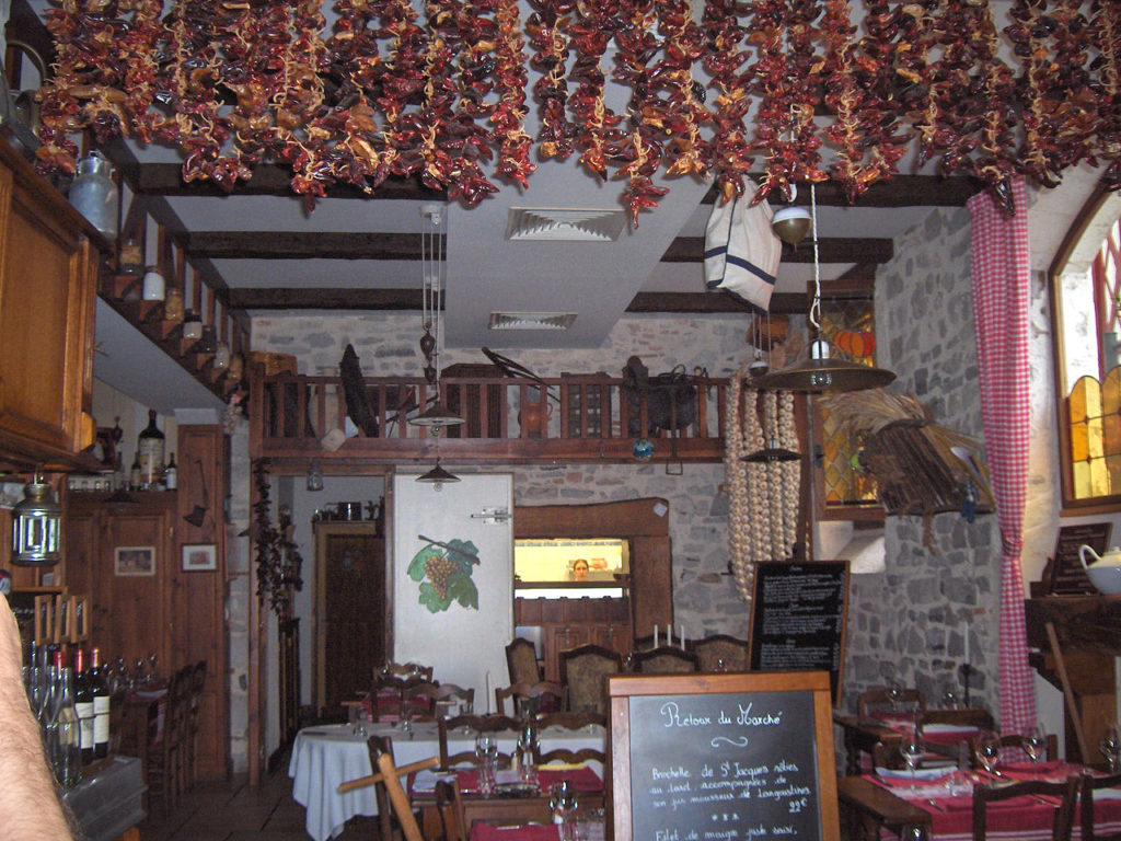 peppers hanging from a ceiling drying in bistro style restaurant in Bayonne