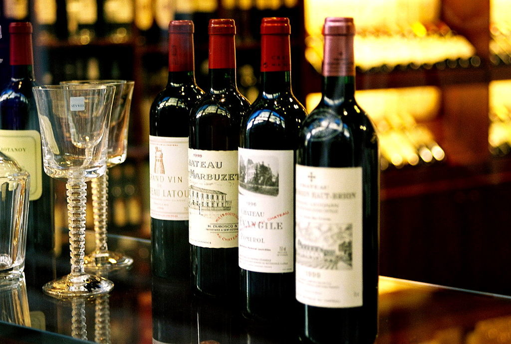 Bottles of top Bordeaux wines with 2 glasses