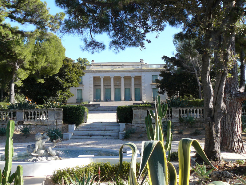Villa Eilenroc with classic facade and gardens in front