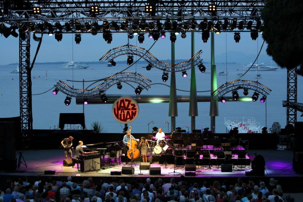 Jazz a Juin festival looking at the stage at night from the stands with sea behind