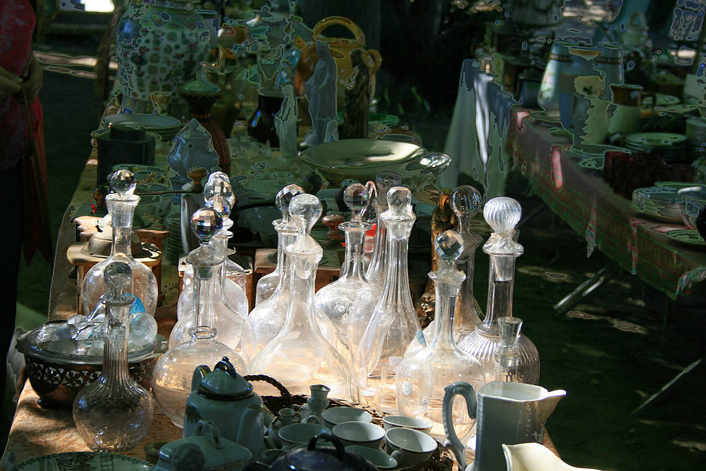 Old glass decanters on table