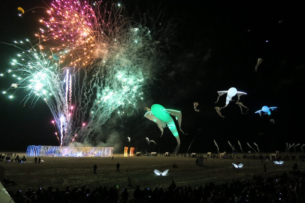 Fireworks with kites at Berck Kite Festival night