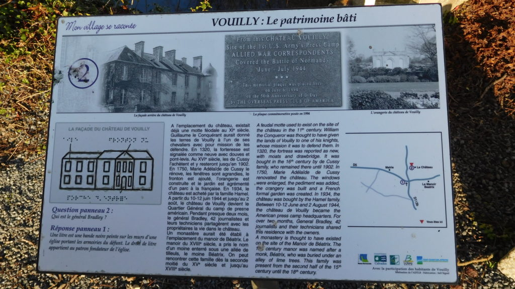 Chateau de Vouilly park sign about the history and WWII war correspondents