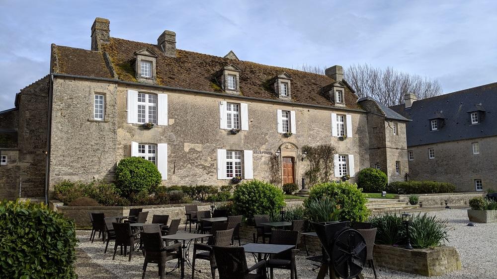 Large manor house exterior in grey stone at the Ferme de la Rançonnière