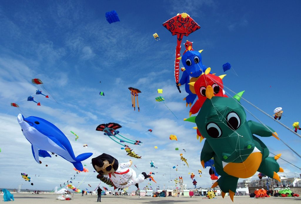 kites flying i nthe sky at Berck Kite Festival e