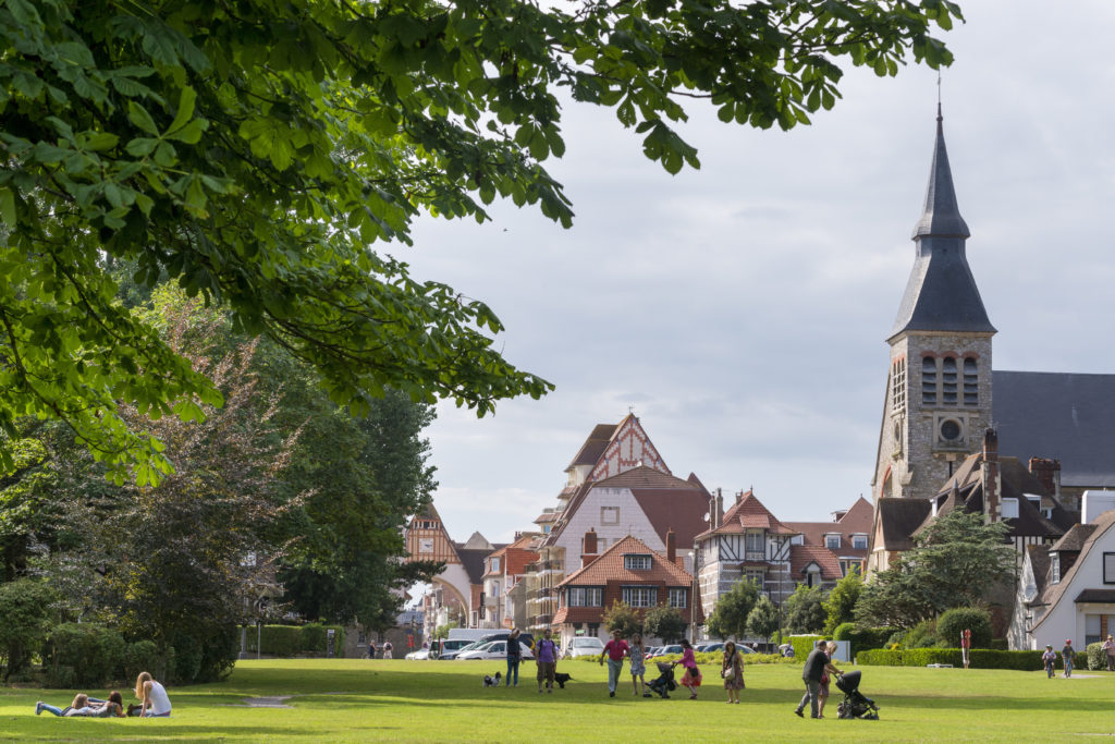 Le touquet with gardens and church and village green with people in front