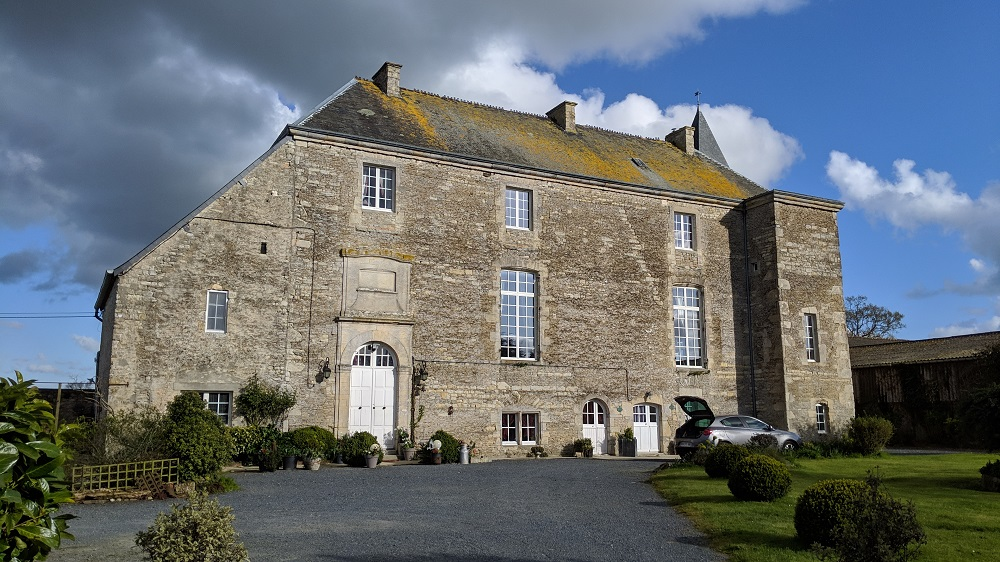 Grey stone 2 storey old manor house in Normandy front view