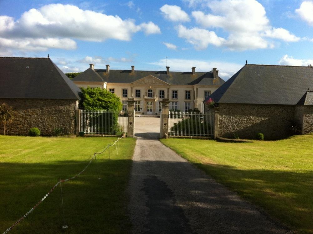 Long low chateau de Quineville normandy seen through frontgates
