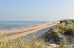 Opal coast north France long sandy beach with dunes in background and sea in front