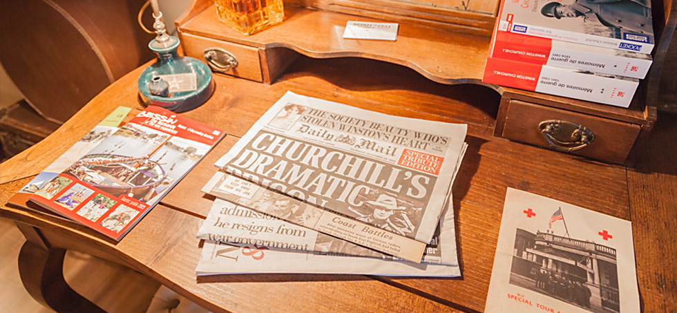 Old newspaper with Winston Churchill headlines on table in Spirit of 1944 B&B