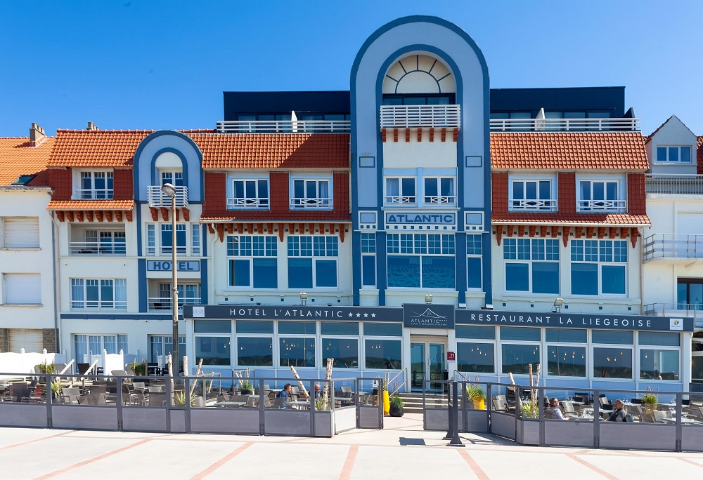 Facade of L'Atlantic hotel Wimereux in trendy design and bright colours