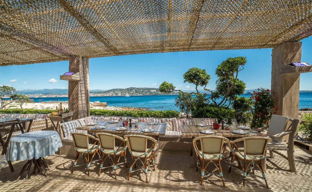 View of the terrace at la guerite restaurant ile ste marguerite with bamboo awning looking out to sea