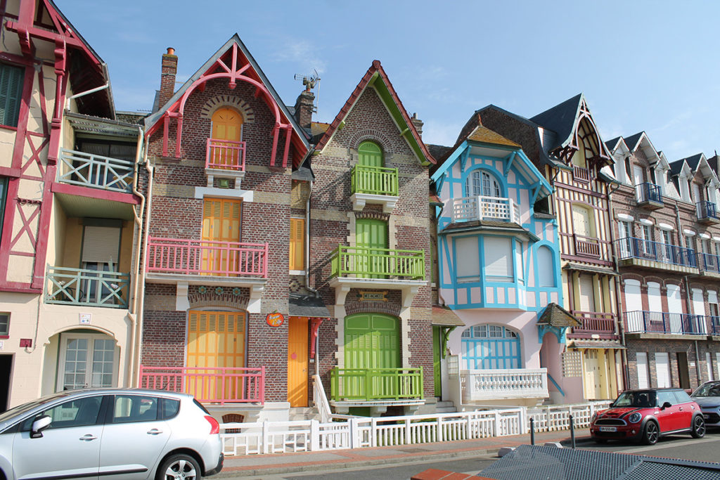 Brightly coloured villas on front at Mers les Bains