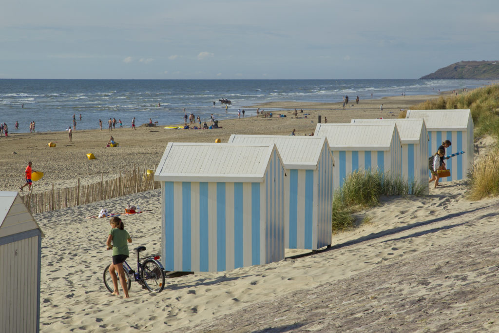 blue and whit striped beach huts at Hardelot