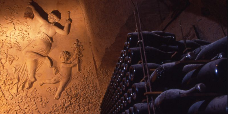 Sculpture carved on rock face of Veuve Clicquot cellar in Reims with bottles