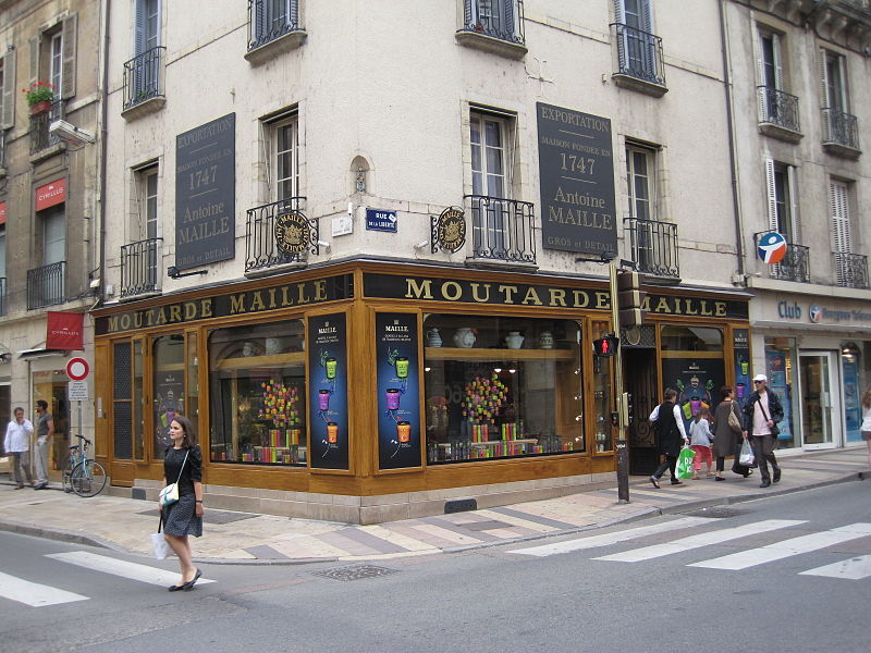 Maille Dijon corner shop with name on outside and mustards in window