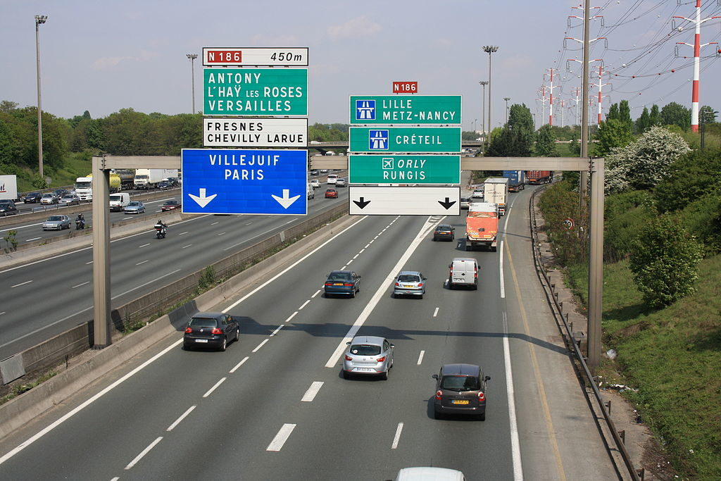 Over view of Frrench autoroute 6 with blue signs to Paris, Versailles and points north