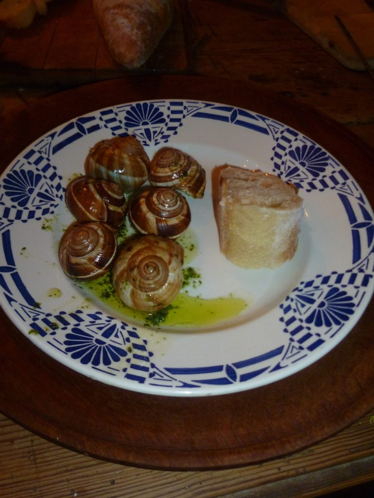 Decorated old plate with Escargots
