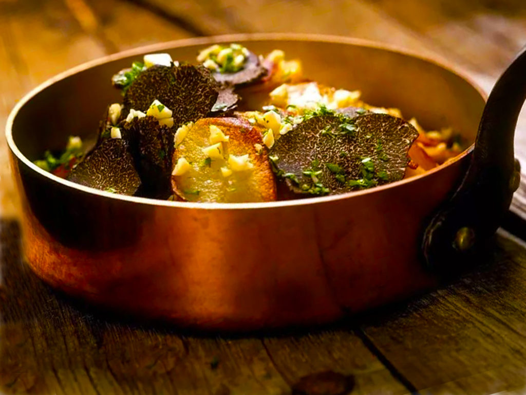 Copper pan full of sauteed truffles