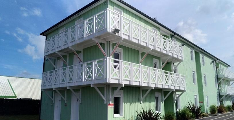 Fast Hotel Caen 3 storey building with wooden balconies