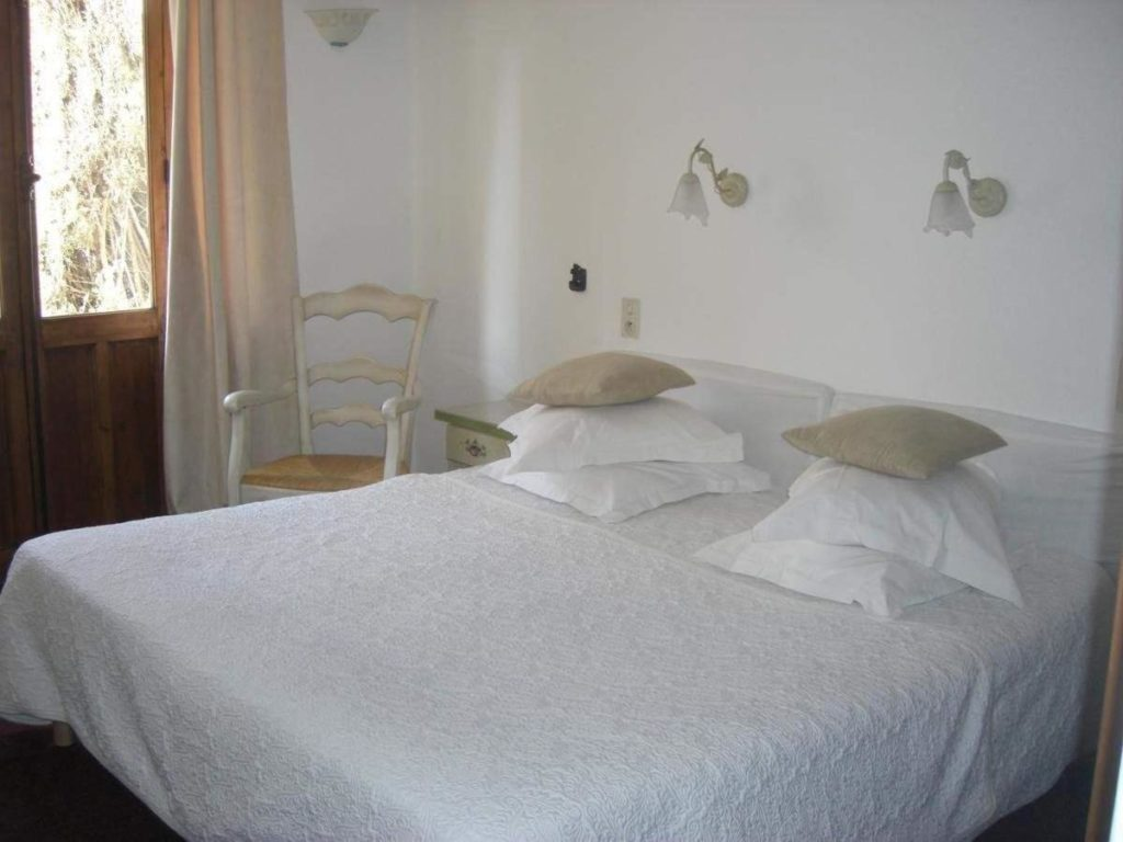 Hotel La Marjolaine bedroom with white textiles