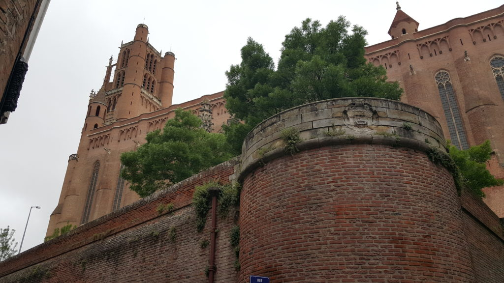 Looking up to wall and cathedral tower behind in Albi