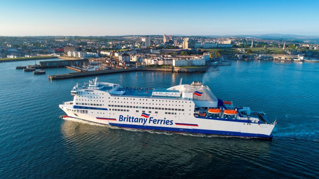 Brittany Ferries arriving at Plymouth with port and town in background
