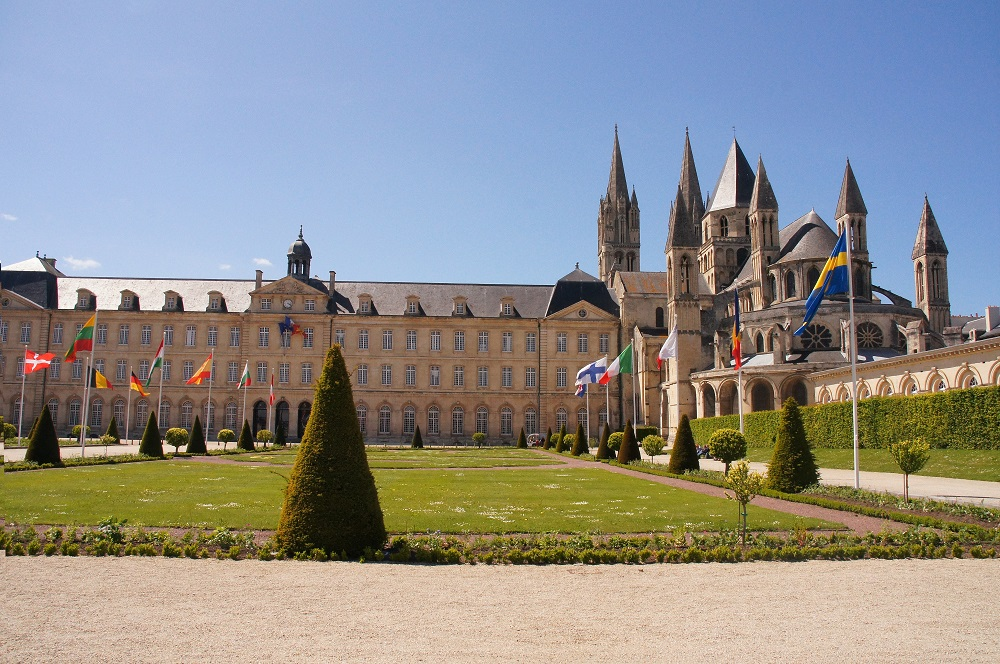 Abbaye aux Hommes stone building with lawn in front in Caen