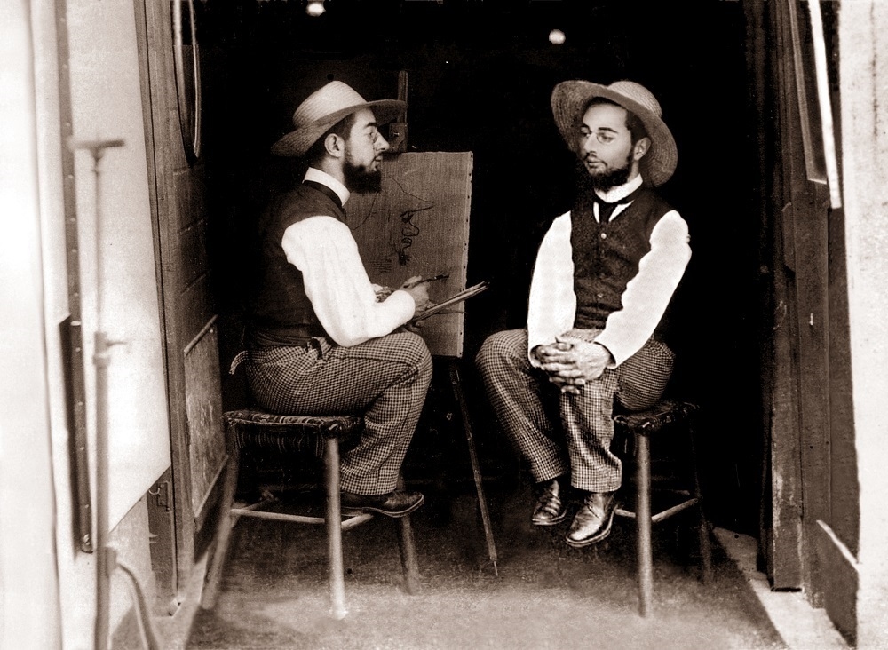 Black and white photograph by Guilbert of Toulouse-Lautrec painting himself entitled Mr Toulouse paints Mr Lautrec